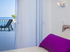 Cozy double bedroom of the lower apartment with playful colors - villa Sunset bay, near Vela Luka