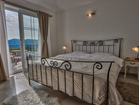 Second bedroom with direct access to the upper terrace with sea view - stone villa with pool and Jacuzzi on Krk Island